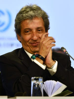 Manuel Pulgar-Vidal, environment minister of Peru, claps after approving the proposed compromise document handed out during the marathon U.N. talks in Lima.