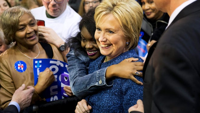 Democratic presidential candidate, Hillary Clinton, right, is embraced by an audience member while posing for a photo at a campaign event at Miles College Saturday, Feb. 27, 2016, in Fairfield, Ala. (AP Photo/David Goldman)