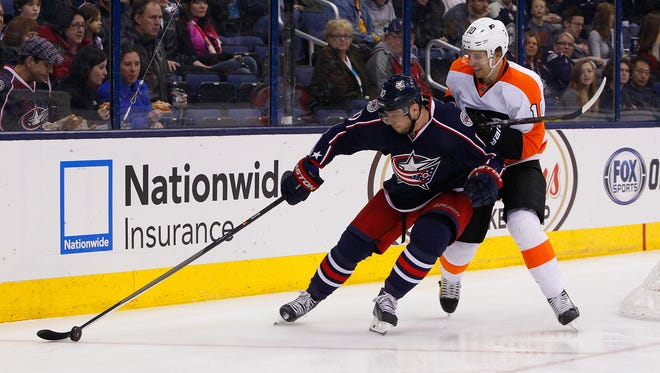 Columbus Blue Jackets right wing Marian Gaborik (10) and Philadelphia Flyers center Brayden Schenn (10) battle for the puck during the first period at Nationwide Arena.