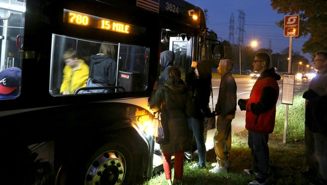 Seniors with cognitive disorder from Sterling Heights High School take a 7:30 am SMART bus outside the high school as they learn to navigate the bus system with the help of PEAC instructors on their way to Somerset Collection on Tuesday, November 1, 2016.
