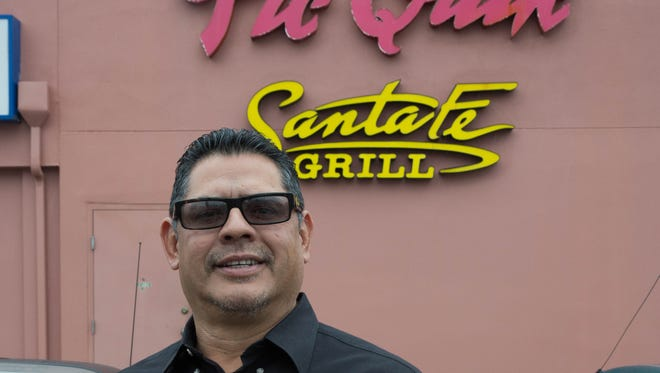 Juan Morales stands in front of the main office and test kitchen of Santa Fe Grill. The grill is located inside Pic Quik stores in southern New Mexico. Friday, Feb. 16, 2018.