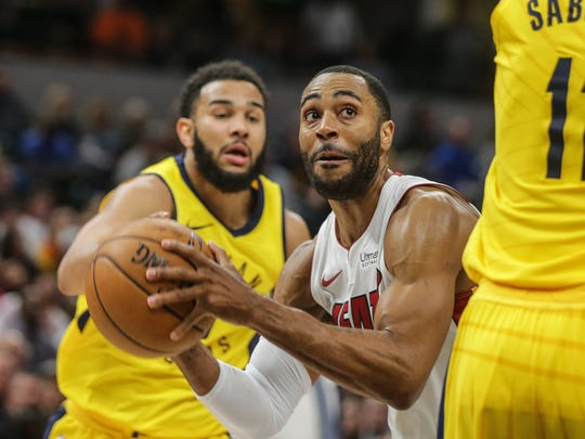 Miami Heat guard Wayne Ellington (2) seeks between Indiana Pacers guard Cory Joseph (6) and Indiana Pacers center Domantas Sabonis (11) for a shot during a game at Bankers Fieldhouse on Wednesday, Jan. 10, 2018. The Heat beat the Pacers 114 to 106.