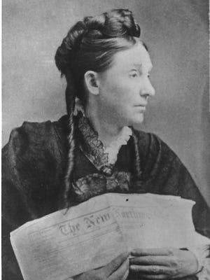 "Abigail Scott Duniway holding an issue of her pro-suffrage newspaper, ""The New Northwest."""