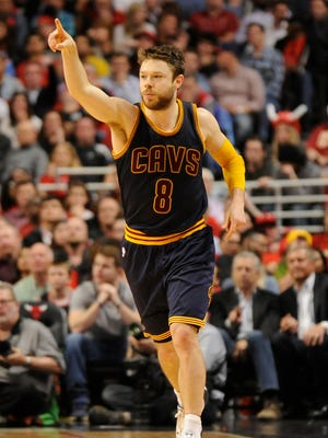 Cleveland Cavaliers guard Matthew Dellavedova (8) reacts after making a three-point basket during the second half in game six of the second round of the NBA Playoffs at  the United Center. The Cavaliers won 94-73.