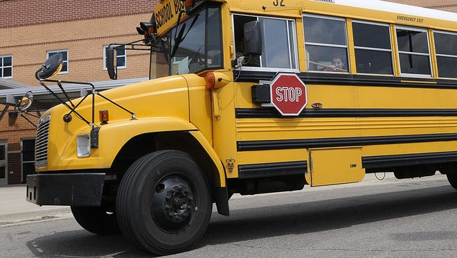 A Hartland school bus driver is being investigated for using a racial slur in a Facebook post.