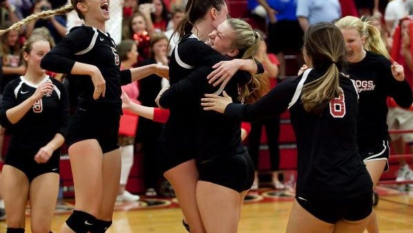 Angela Grieve (center left) and Katherine Andros (center right) of South Fork High School celebrate the Bulldog's win over Barron Collier High School during the 2016 FHSAA 7A Volleyball State Semifinals in Tropical Farms on Nov. 5, 2016.