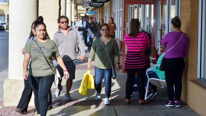 Shoppers filled the Tulare Outlet Mall Tuesday to purchase items with gift cards and make some holiday gift returns.