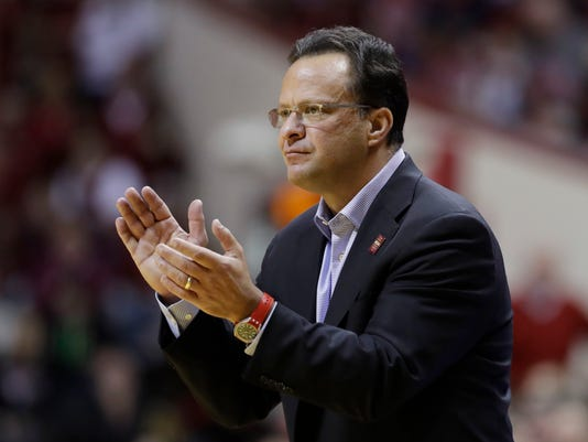 FILE - In this Jan. 7, 2017, file photo, Indiana coach Tom Crean applauds during the team's NCAA college basketball game against Illinois in Bloomington, Ind. Georgia has hired former Indiana coach Crean as its coach, capping a fast-paced search that began when Mark Fox was fired on Saturday. Crean was hired one day after former Ohio State coach Thad Matta withdrew from consideration. Georgia announced the hire Thursday night, March 15. (AP Photo/Darron Cummings, File)