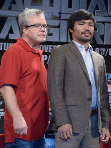 Freddie Roach (left) will train Manny Pacquiao for