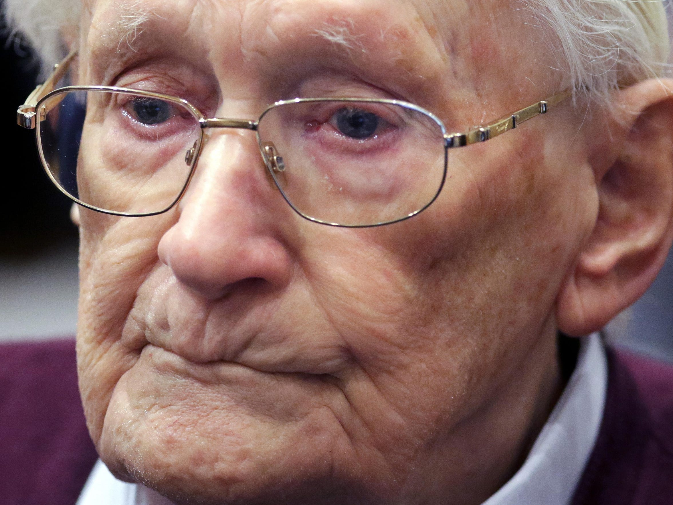 94-year-old former SS Sgt. Oskar Groening listens to the verdict of his trial Wednesday, July 15, 2015, at a court in Lueneburg, northern Germany. Groening, who served at the Auschwitz death camp was convicted on 300,000 counts of accessory to murder and given a four-year sentence. (Axel Heimken/Pool Photo via AP)