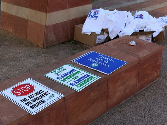 Signs and t-shirts promoting workers' rights and Working