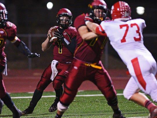 Roosevelt quarterback Torren Devericks (1) looks for