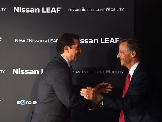 José Muñoz, Chief Performance Officer of Nissan Motor Company and Chairman of Nissan North America and  Governor Bill Haslam greet each other during the launch of all-new Nissan LEAF at the Nissan Smyrna plant on Monday, Dec. 4, 2017.