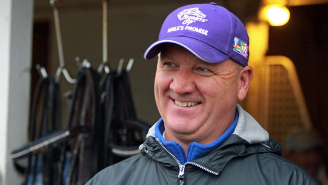 Trainer Ken McPeek smiles at Churchill Downs in April of 2010.