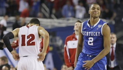 Kentucky freshman Aaron Harrison has been clutch in the NCAA Tournament.