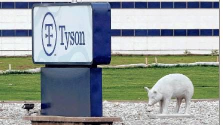 In this May 1, 2020, file photo, a sign sits in front of the Tyson Foods plant in Waterloo, Iowa. A group of worker advocacy organizations has filed a civil rights complaint with the U.S. Department of Agriculture alleging that meat processing companies Tyson and JBS have engaged in workplace racial discrimination during the coronavirus pandemic. The complaint alleges the companies adopted polices that reject U.S. Centers for Disease Control and Prevention guidance on distancing and protective gear on meat processing lines. The complaint says the operating procedures have a discriminatory impact on mostly Black, Latino, and Asian workers.