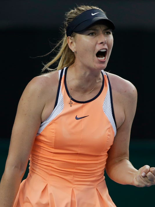 Maria Sharapova of Russia celebrates a point win over Nao Hibino of Japan during their first round match at the Australian Open tennis championships in Melbourne, Australia, Monday, Jan. 18, 2016.(AP Photo/Aaron Favila)