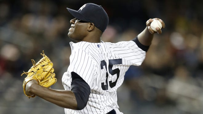 Yankees starting pitcher Michael Pineda  delivers in the third inning  against the Boston Red Sox at Yankee Stadium on Thursday.