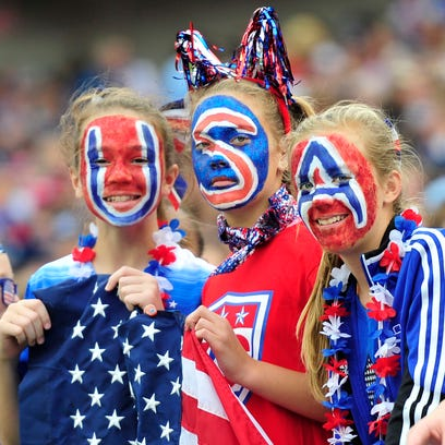 USA fans show their support during the first half against