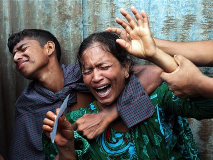 Bangladeshi woman Munni, whose daughters are missing, cries as rescuers search the River Padma after a passenger ferry capsized in Munshiganj district, Bangladesh, Aug. 4, 2014.