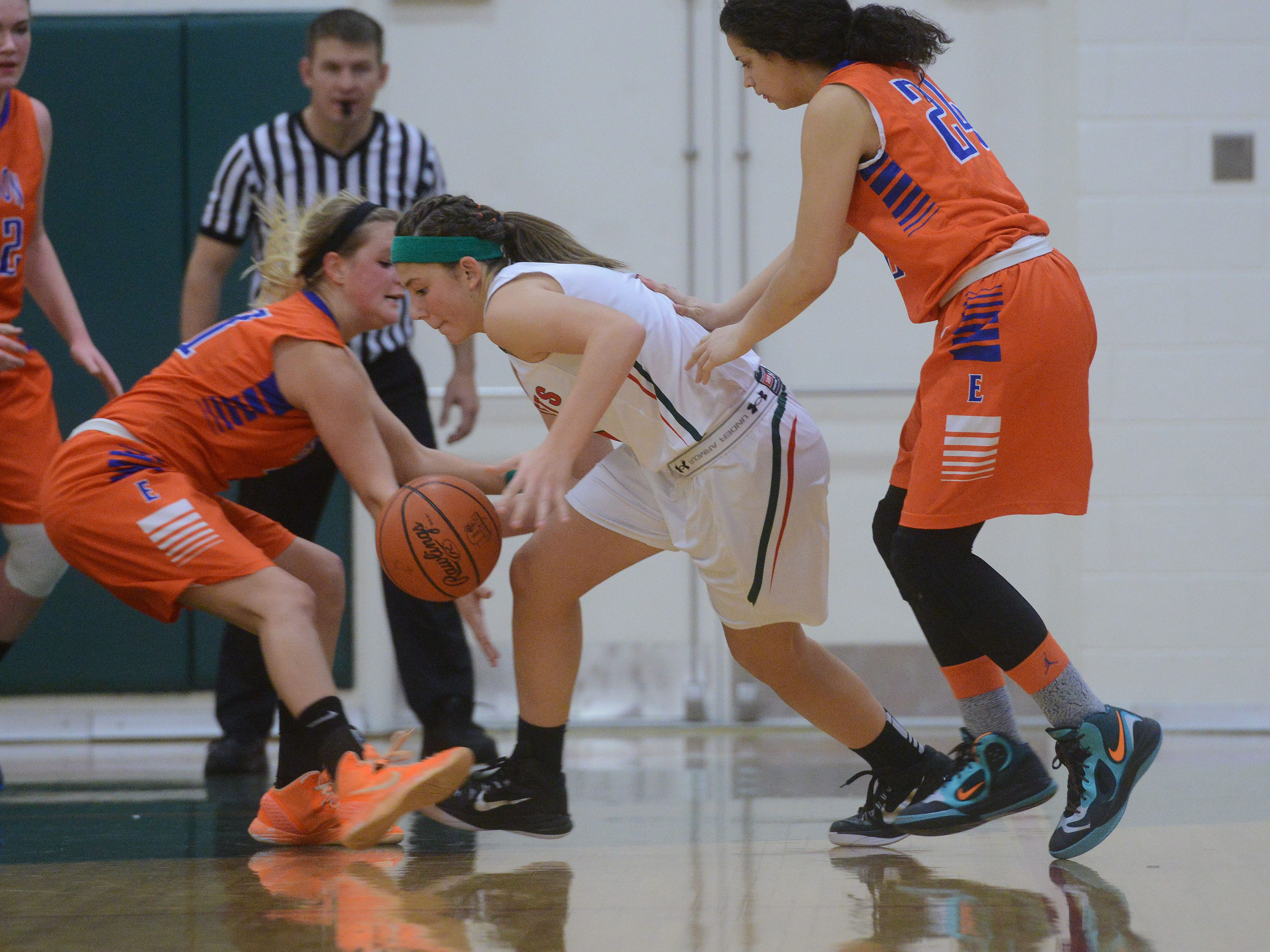 Oak Harbor's Emma Barney is fouled as she comes up with a turnover late in the fourth quarter of a basketball game against Edison on Thursday, Dec 4, 2014.