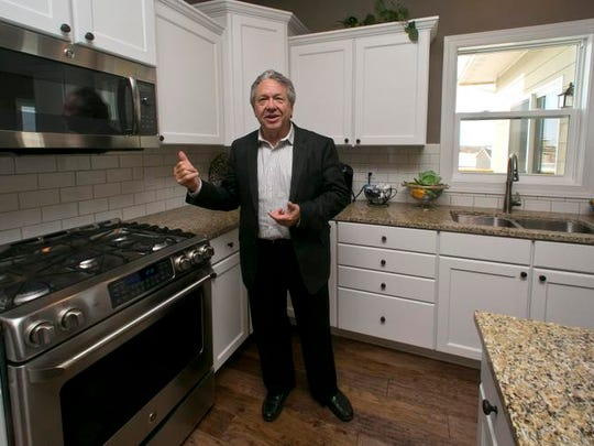 Hubbell Realty CEO Rick Tollakson shows off a kitchen during the Hubbell Living Home Show in Urbandale in 2013.