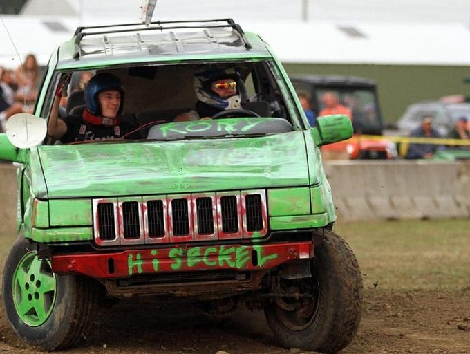 Driver Kory Seckel and navigator Colton Jenkins fight to keep their Jeep Cherokee on the track during the Tough Truck competition held at the Marion County Fair on Wednesday, July 2, 2014.