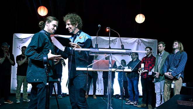 Music student David Francisco, of Knoxville, receives his diploma from Mark Rubel during the Blackbird Academy graduation in Nashville on June 30, 2017. Francisco became paralyzed three weeks into his six-month program at Blackbird Academy after a car hit his bicycle last year. After eight months of physical rehab, Francisco returned to Blackbird and walked for the first time unaided at his graduation.