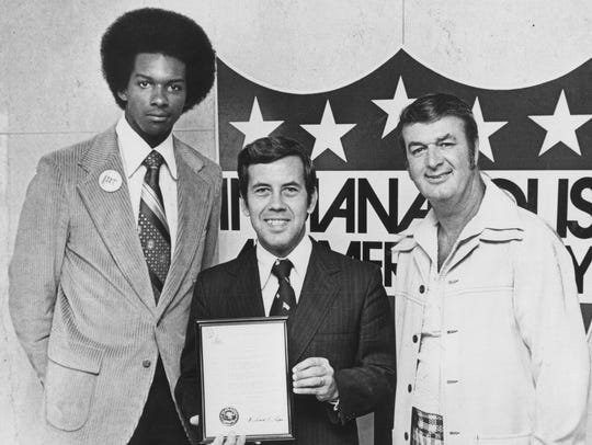 Indinaapolis Mayor Richard Lugar (center) holds a proclamation