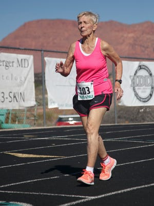 Dottie Gray runs on the track at Snow Canyon High School during Huntsman World Senior Games competition Wednesday, Oct. 7, 2015.