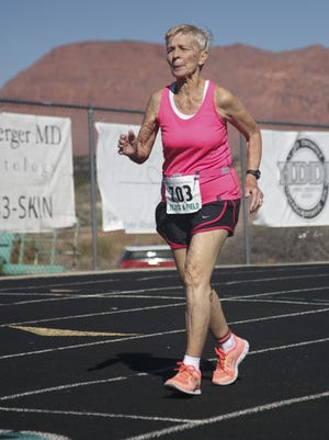 Dottie Gray runs at Snow Canyon High School during the Huntsman World Senior Games competition in Utah in 2015. Now 92, she is among the runners at Bass Pro events Sunday.