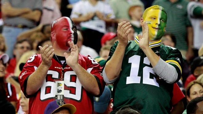 A pair of fans show their colors during the fourth quarter of the Green Bay Packers - Atlanta Falcons game Sunday, October 9, 2011 at the Georgia Dome in Atlanta, Ga. The Packers beat the Atlanta Falcons 25-14.  MARK HOFFMAN/MHOFFMAN@JOURNALSENTINEL.COM