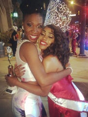 Nicole Lyn hugs fellow contestant Colleen Miles after winning the Miss Black America pageant in Philadelphia earlier this month.