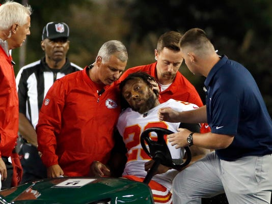 FILE - In this Sept. 7, 2017, file photo, Kansas City Chiefs safety Eric Berry (29) is consoled after he was put on a cart following an injury during the second half of an NFL football game against the New England Patriots, in Foxborough, Mass. Everyone is wondering why there have been so many injuries in 2017. (AP Photo/Michael Dwyer, File)