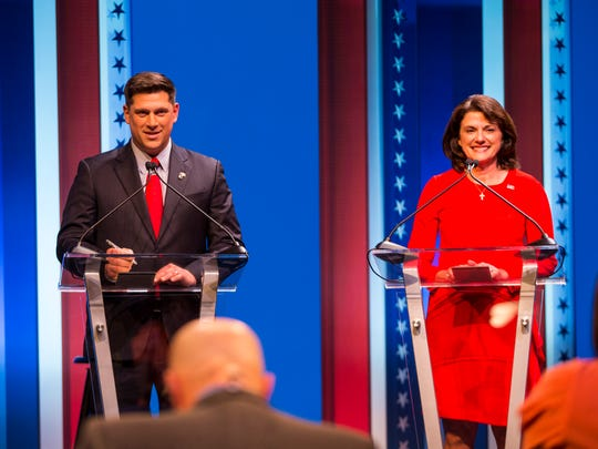 Republican U.S. Senate candidates Kevin Nicholson and Leah Vukmir stand at their podiums at the start of a debate at the University of Wisconsin-Milwaukee Thursday.