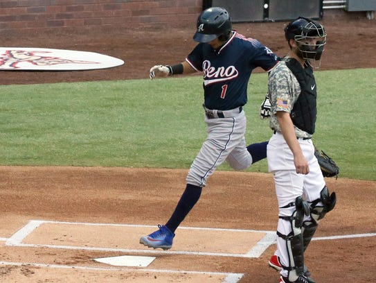 Ildemaro Vargas, 1, of the Reno Aces steps on the plate