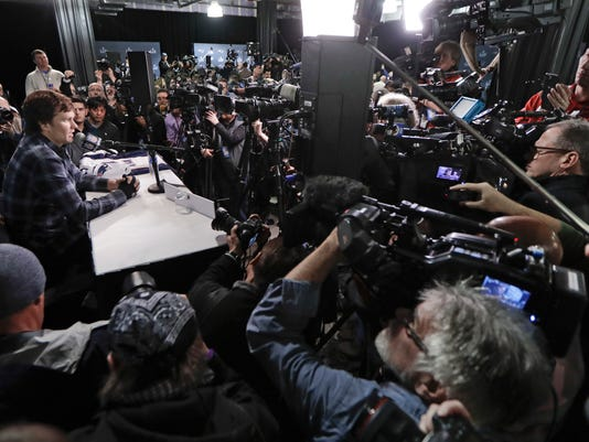 FILE - In this Thursday, Feb. 1, 2018, file photo, with cameras covering multiple angles, New England Patriots quarterback Tom Brady answers questions during a news conference in Minneapolis. The Patriots are scheduled to face the Philadelphia Eagles in the NFL Super Bowl 52 football game, Sunday, Feb. 4. You can watch the game online for free, and it'll be easier to do so as phone viewing is no longer limited to Verizon customers. (AP Photo/Mark Humphrey, File)