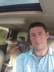 Adrian Murfitt, 35, a commercial fisherman from Anchorage, seen here with his West Siberian Laika named Paxson, was one of the victims of the shooting in Las Vegas on Oct. 1, 2017.