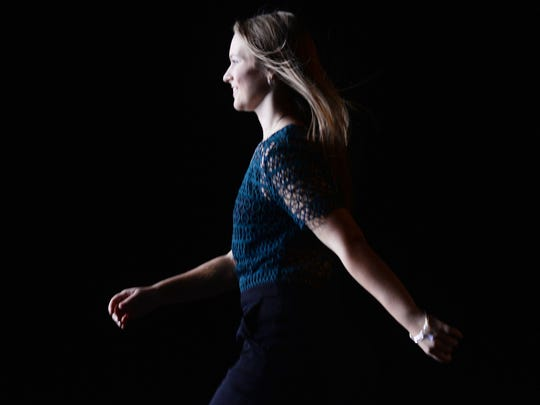 Loyola senior Alie Faust takes charge of the stage at  style show.