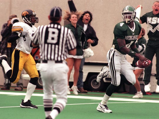 MSU receiver Plaxico Burress, right, runs untouched