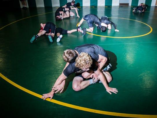 Yorktown wrestlers practice in their new uniforms at