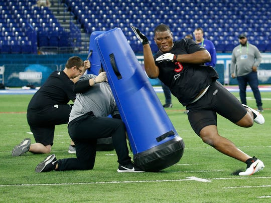 Feb 29, 2020; Indianapolis, Indiana, USA; Auburn Tigers defensive lineman Derrick Brown (DL03) goes through a workout drill during the 2020 NFL Combine at Lucas Oil Stadium. Mandatory Credit: Brian Spurlock-USA TODAY Sports