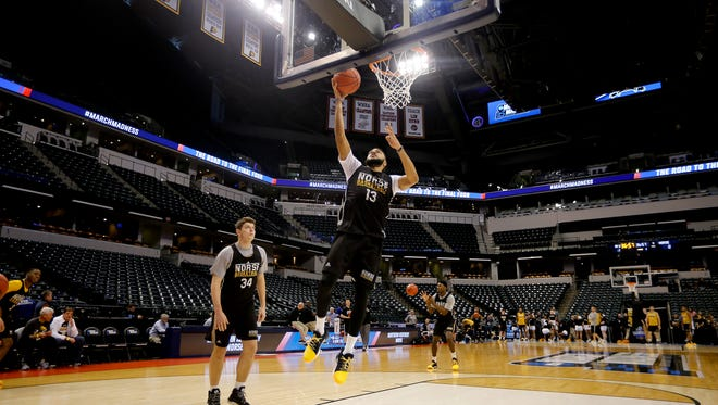 Northern Kentucky Unviersity's Brennan Gillis makes a lay-up during practice at Bankers Life Fieldhouse in Indianapolis  Thursday March 16, 2017. NKU earned the No. 15 seed in the South Region and will play No. 2-seed Kentucky in the opening round of the NCAA Men's Basketball Championship in Indianapolis on Friday.