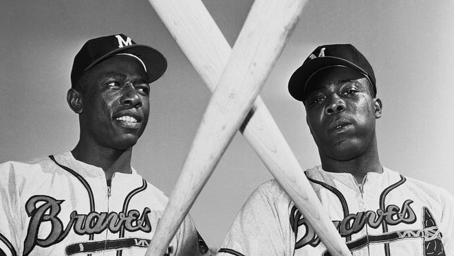 Hank Aaron, left, and his brother, Tommie, combined for 768 homers.