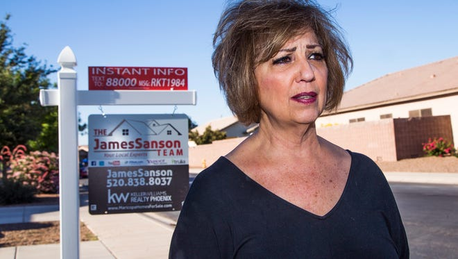 Cynthia Levine is faced with losing her Maricopa home to foreclosure. After losing her business and getting behind in her HOA payments, foreclosure proceedings were started.  She talks about her ordeal outside her home May 3, 2017.