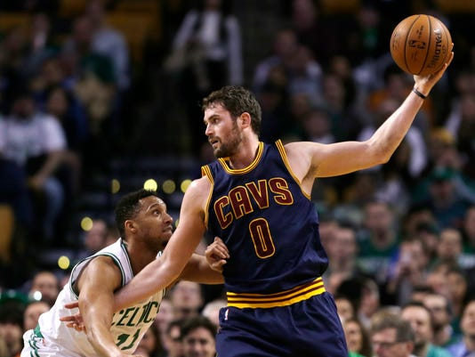 FILE- In this April 23, 2105, file photo, Cleveland Cavaliers forward Kevin Love (0) looks to pass during the first quarter of a first-round NBA playoff basketball game in Boston. Love, whose arm was yanked from the socket on Sunday by Boston's Kelly Olynyk during Game 4, had the operation at the Hospital for Special Surgery in New York on Wednesday, April 29, 2015. (AP Photo/Charles Krupa, File)