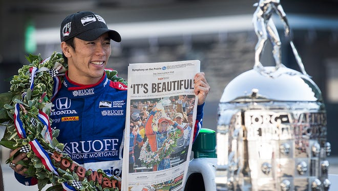 Andretti Autosport IndyCar driver Takuma Sato, winner of the 101st running of the Indianapolis 500, holds a copy of the Indianapolis Star at Indianapolis Motor Speedway Monday, May 29, 2017.