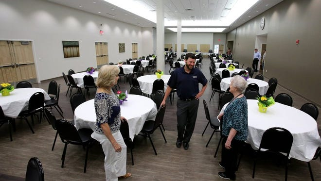 """Loretta Duncan (left), Wes Brown and Dee Dempsey discuss arrangements before last summer's  dedication ceremony for Southaven's Senior Center at Snowden Grove Park. Improvements were made to the baseball complex and amphitheater as well, using the city's """"Penny For Your Parks"""" restaurant tax."""