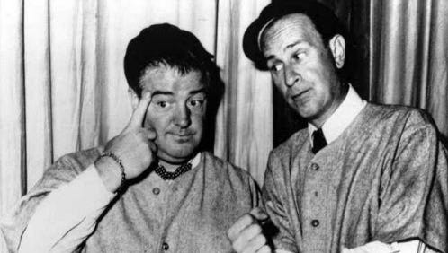 Bud Abbott, right, and his partner Lou Costello, do their famous baseball sketch.