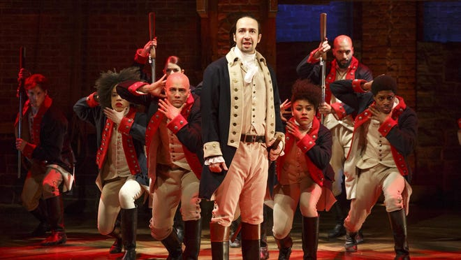 """This image released by The Public Theater shows Lin-Manuel Miranda, foreground, with the cast during a performance of """"Hamilton,"""" in New York. (Joan Marcus/The Public Theater via AP)"""